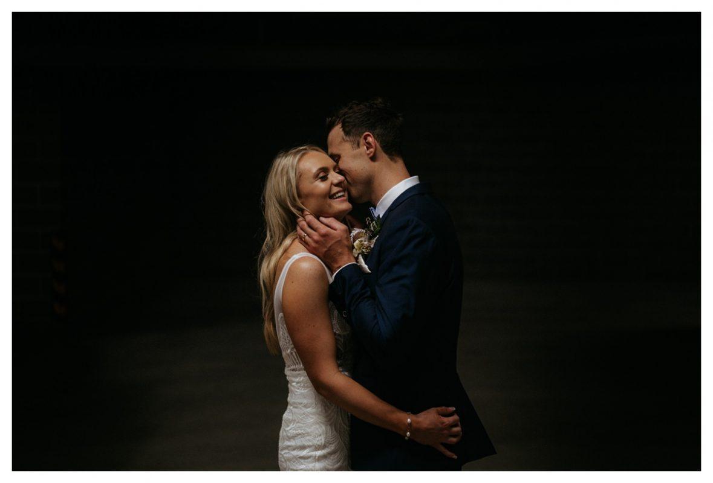 A bride and groom having a cuddle at their Headlands Hotel wedding