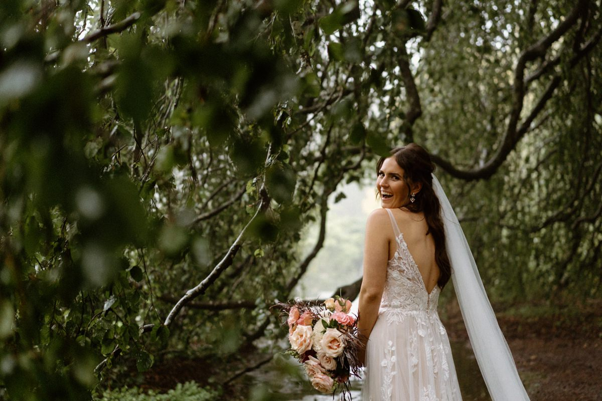 A bride in the rain at her Milton Park wedding.