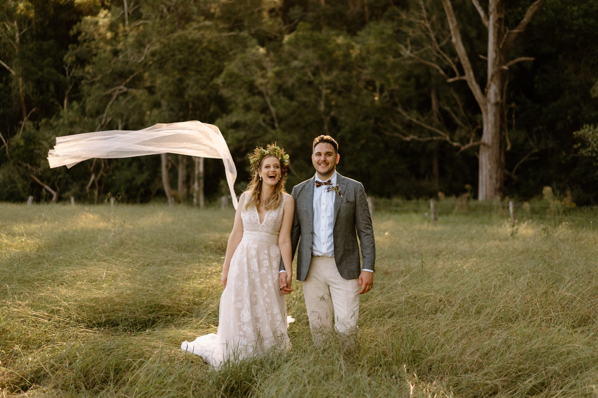 a couple laughing at their willow farm berry wedding!