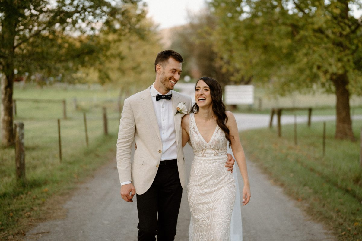A newly wedded kangaroo valley couple hugging at their barn on Melross wedding
