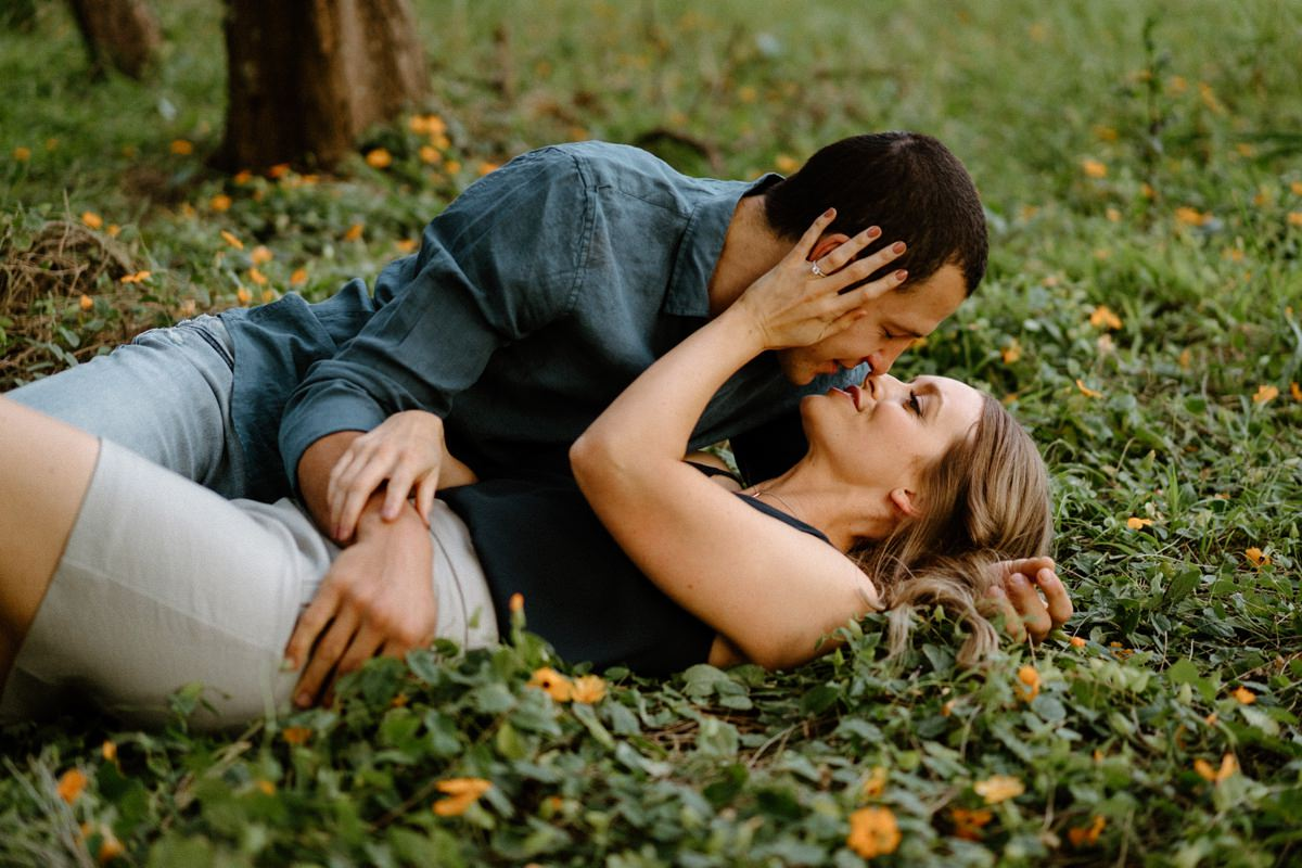 a lovely couple laying in the grass on their Illawarra engagement shoot